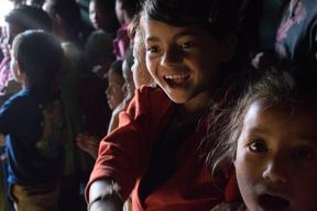 Jamuna Nepali, 9, laughs while attending a UNICEF-supported Child Friendly Space