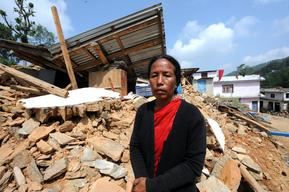 Saraswoti Karki, auxiliary nurse and midwife (ANM) of Jalkeni health post stands in front of the collapsed health post