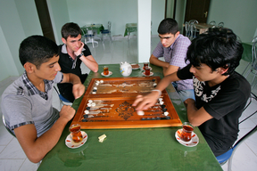 Boys playing table game at the Youth center