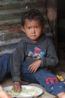 Young boy eating rice in Baluwa village in Gorkha district