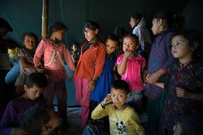 Jamuna Nepali, 9, and other children attend a UNICEF-supported Child Friendly Space