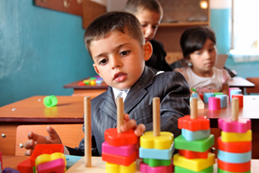 Little Ali, 5 playing in class in the UNICEF supported pre-school