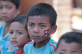 """Suvam Maharjan, face painted with a Nepali flag and """"I love Nepal"""""""