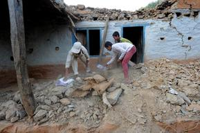 Digging out their text books and notebooks from under the rubbles of their house