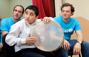 UNICEF Goodwill Ambassadors Philipp Bohnen listening to children with visual impairment play music
