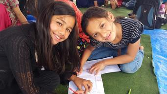 Two girls in UNICEF supported art therapy session